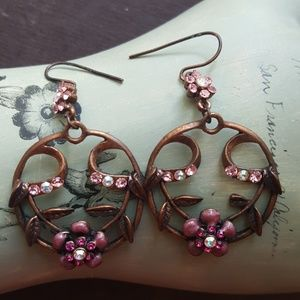 Pink floral and copper metal dangle earrings.